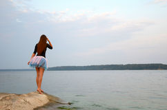 Woman waiting near the lake Royalty Free Stock Photography