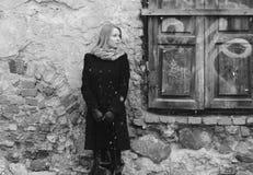 Woman waiting near the retro wall Stock Photos