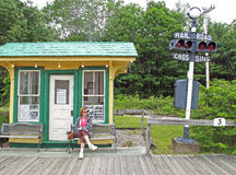 Woman waiting at old railroad station Kennebunkport Maine Stock Photography