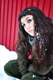 Woman waiting outside in winter time. Beautiful young woman waiting outside in winter time Stock Photo