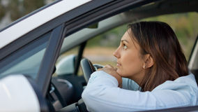 Woman waiting patiently in her car Royalty Free Stock Photography