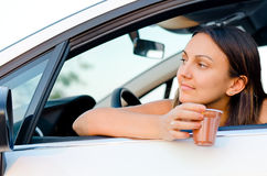 Woman waiting patiently in her car Stock Image