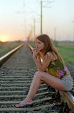 Woman waiting on railroad Royalty Free Stock Photo