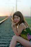 Woman waiting on railroad Stock Images