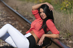 Woman waiting on railroad. Young woman waiting on railroad Royalty Free Stock Photography