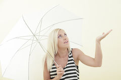 Woman waiting for the rain Stock Image