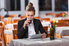 Woman Waiting at Restaurant Stock Images