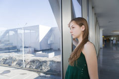 Woman waiting someone. In modern building Stock Image