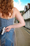 Woman waiting on street with gun Royalty Free Stock Photos