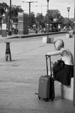 Woman waiting with suitcase in front of the train station in Mulhouse Royalty Free Stock Photos