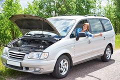 Woman waiting to help and thumbs up from car Royalty Free Stock Image
