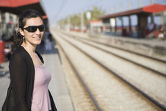 Woman waiting for train Royalty Free Stock Images
