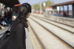Woman waiting for train Stock Images