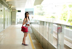 Woman waiting for train Stock Photo