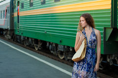 Woman waiting train on the platform Stock Photo