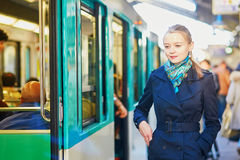 Woman waiting for a train on the platform of Parisian underground Royalty Free Stock Images