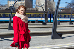 Woman waiting train on the platform of railway station Royalty Free Stock Photos