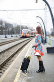 Woman waiting train and see other coming Royalty Free Stock Photos