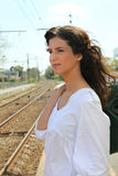 Woman waiting at train station. Young woman waiting at train station Royalty Free Stock Photography