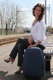 Woman waiting at train station Royalty Free Stock Photos