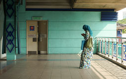 A woman waiting at the train station in Kuala Lumpur, Malaysia Royalty Free Stock Photo