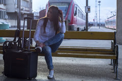 Woman waiting on a train station Royalty Free Stock Photo