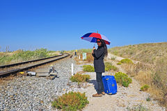 Woman waiting for the train Royalty Free Stock Photos
