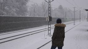 Woman waiting the train in winter. Woman waiting the train in snow and frost stock footage