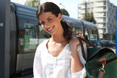 Woman waiting for the tram. To arrive Royalty Free Stock Photography