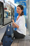Woman waiting at tram station Stock Photography