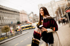 Woman waiting for transport in the city on streets Royalty Free Stock Photography