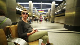 Woman waiting on underground station. Of Moscow Metro, Moscow, Russia stock video