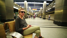 Woman waiting on underground station. Of Moscow Metro, Moscow, Russia stock video footage