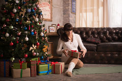 Woman is waitng a baby for christmas Royalty Free Stock Image
