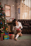 Woman is waitng a baby for christmas Royalty Free Stock Photography