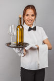Woman waitress with a bottle of wine and wineglass royalty free stock images