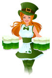 Woman waitress Patrick holds glass of green beer Stock Photo