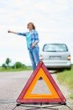 Woman waits help near car Royalty Free Stock Photography
