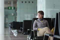 Woman waits her flight Royalty Free Stock Photography
