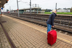 Woman waits for her train station Stock Image