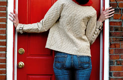 Woman Waits at Red Door Stock Images