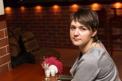 Woman waits a waiter Stock Photo