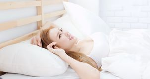 Woman wake up. On bed in the morning stock photo
