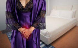 The woman wake up for go to restroom. The woman in  purple satin sleepwear and robe wake up for go to restroom. People with urinary bladder problem concept Stock Image