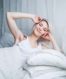 Woman wakes up Royalty Free Stock Photo