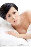 Woman wakes up in bed. White background Stock Photography