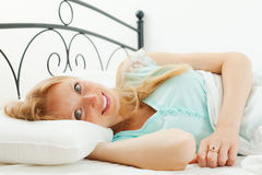 Woman wakes up in her bed Royalty Free Stock Photos