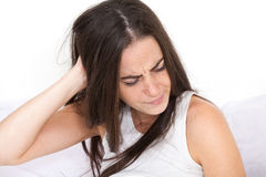 Woman wakes up with a sore head Royalty Free Stock Photo