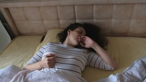 Woman wakes up from terrible dream and pulls hands in front of her from horror. stock video footage