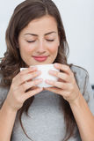 Woman waking with the scent of coffee Royalty Free Stock Photography